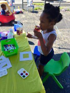 Kid Enjoy Juice while Painting