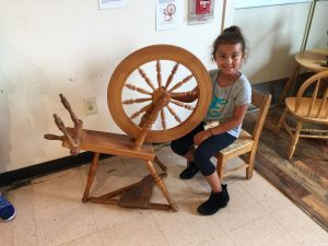 Child Playing With Wheel